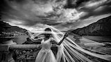 cristiano-ostinelli-sony-alpha-7RIII-bride-holding-up-veil-with-ocean-behind