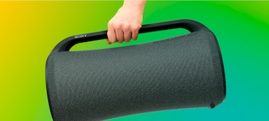 The SRS-XG500 speaker with a hand holding the easy-to-grip top handle.