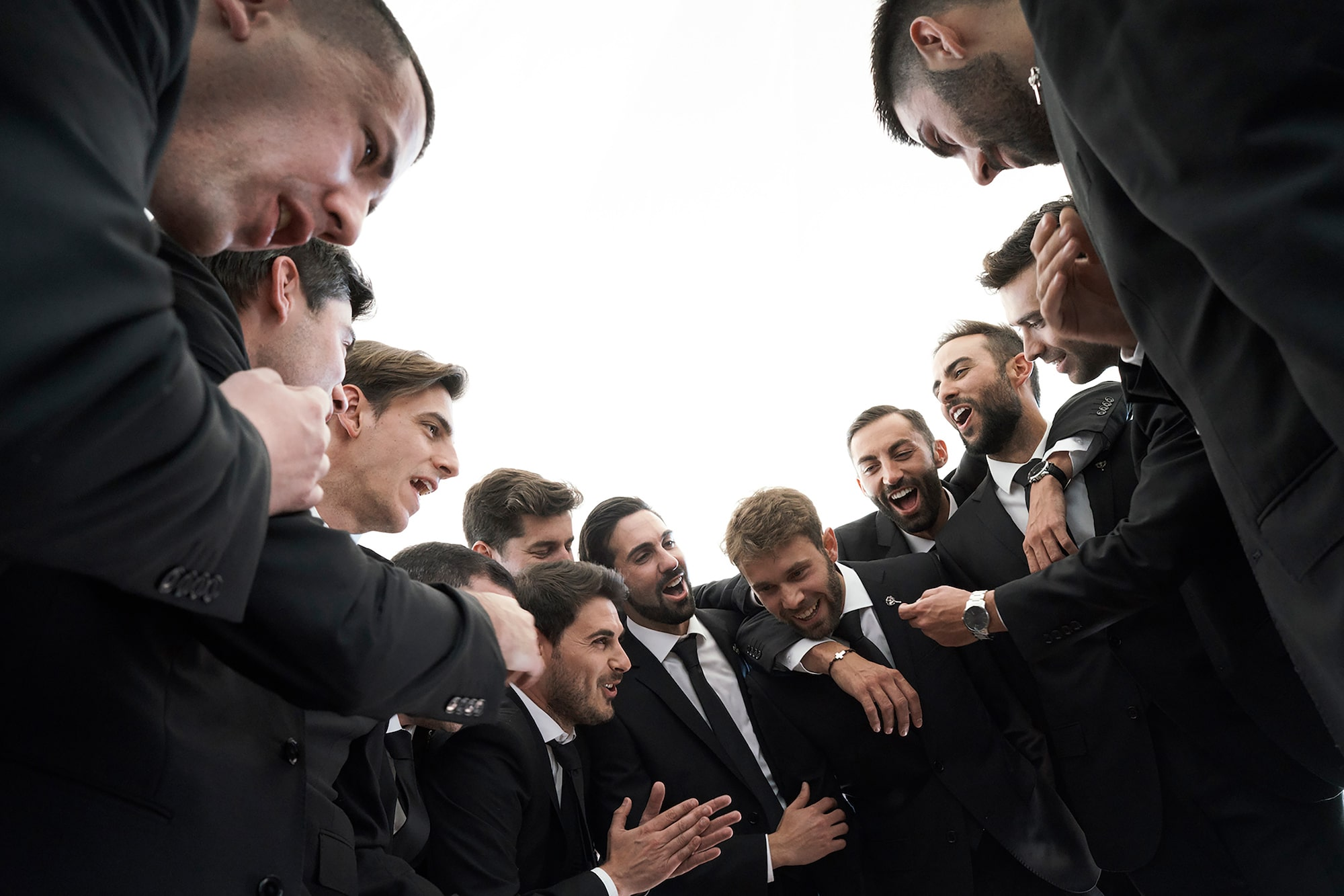 jorge miguel jaime baez sony alpha 7RIII the groom and his best men stand in a circle embracing each other