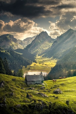 ilhan eroglu sony alpha 7R II picturesque cottage in mountainous landscape with dramatic clouds
