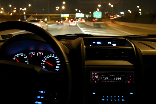 Night time shot of the MEX-N4300BT coloured display matching the car's dashboard