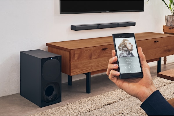 Image showing a phone with bluetooth connectivity and the HT-S40R in a living room