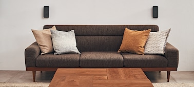 Sofa with wireless speakers behind