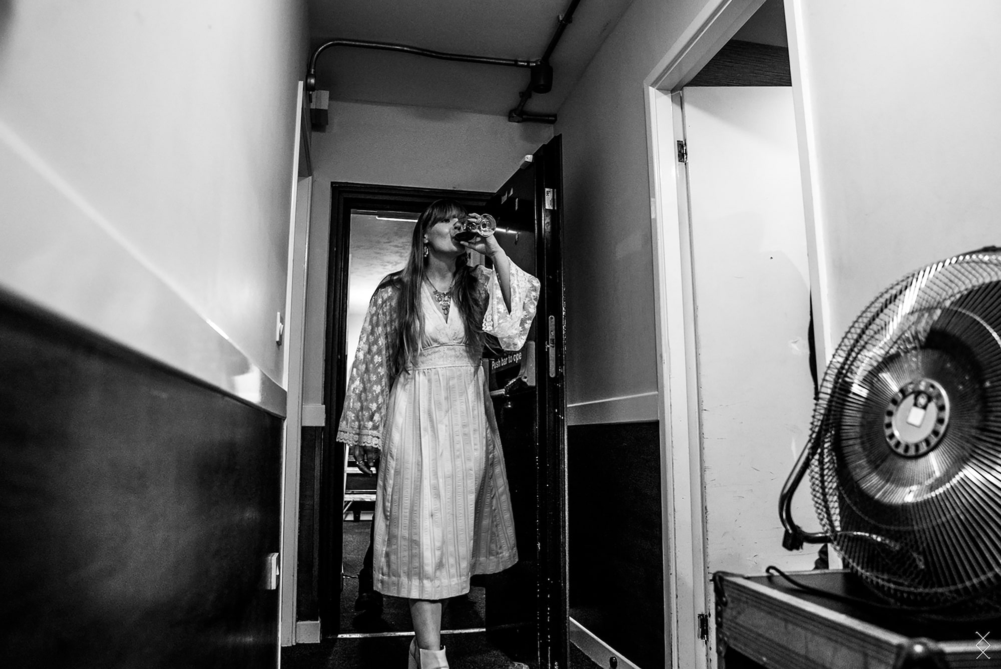 maaike ronhaar sony alpha 7SII courtney marie andrews tips a glass of wine back as she waits backstage at a concert