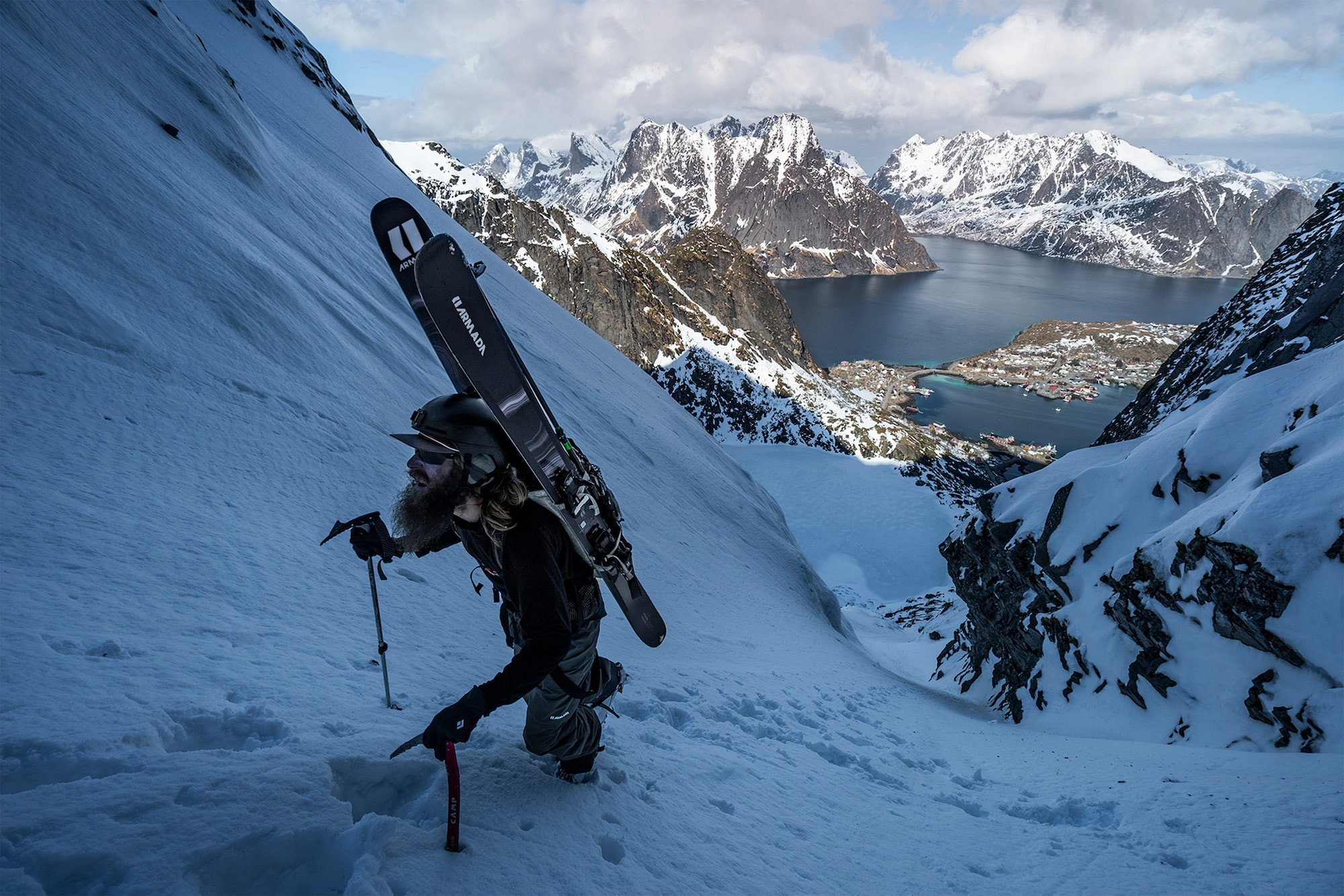 daniel ronnback sony alpha 9 a skier makes his way up a steep snow covered mountainside
