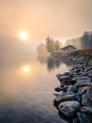 michael schaake sony alpha 7RIII wooden cabin by a still lake at misty dawn