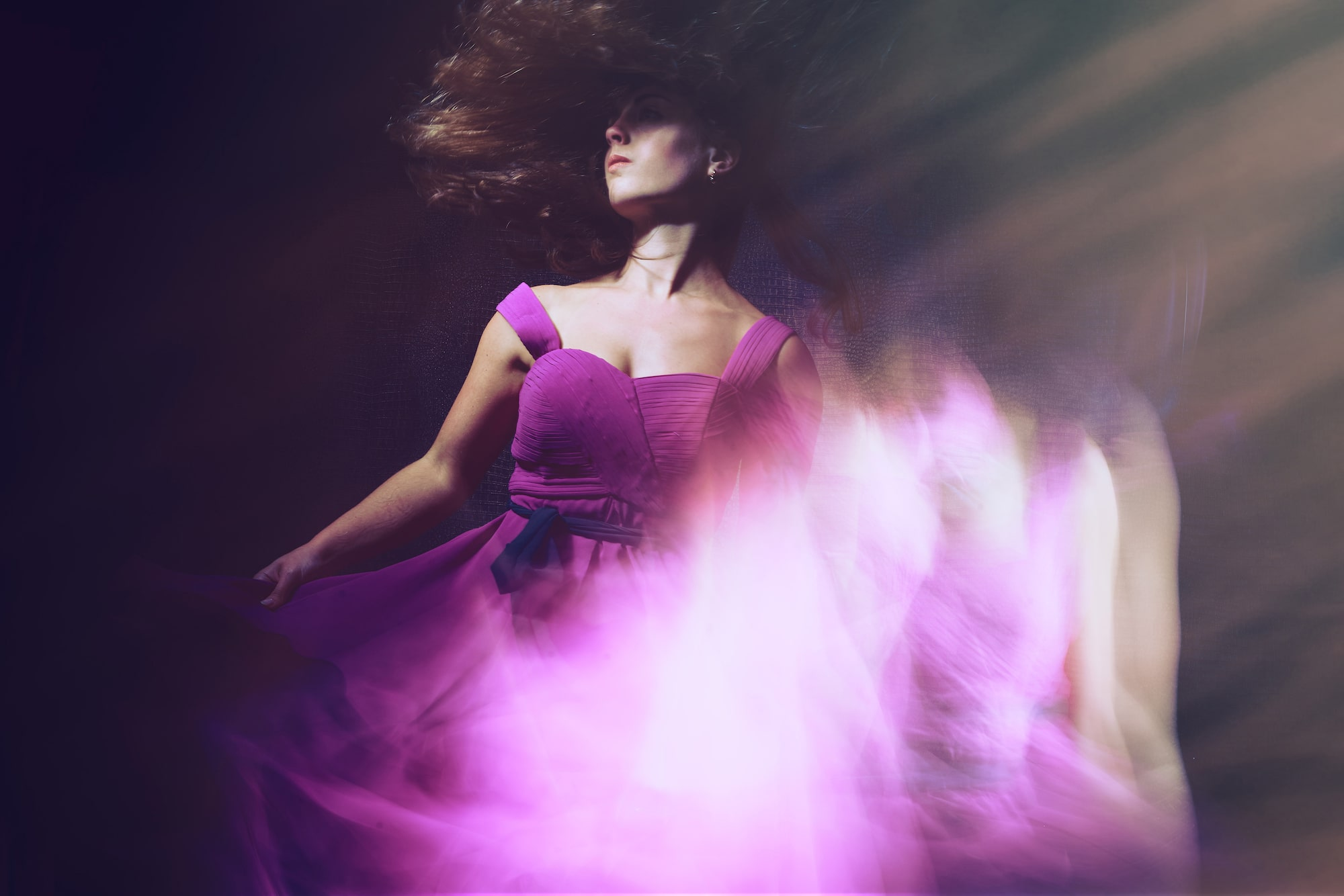 frank doorhof sony alpha 7RM3 multiple exposure shot of a lady wearing a purple dress and shaking her head