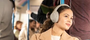 WH-1000XM4 headphones on a train